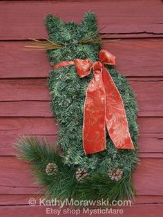 Celebrate your home or barn cats this holiday in style! These classy artificial pine Cat Wreaths can be used every year or be kept on display all year