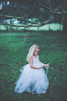 flower girl in tulle, photo by Papered Heart Photography http://ruffledblog.com/brooksville-florida-wedding #weddingideas #flowergirls #tulledress