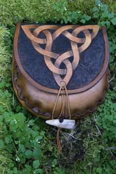 small belt pouch in tan leather with hand carved triple knot and detailed belt loop