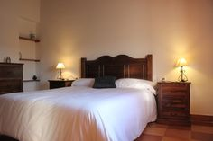 Our rooms | MAS SALOM | Turisme Rural. Relax in our rustic bedrooms while you discover the panoramic views of the courtyard and fields. #caldesdemalavella #girona #rural #turismerural #accommodation #costabrava #laselva #caldes #turisme #masia