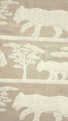 Pride Linen Fabric Linen fabric with large embroidered design of lions in cream on a neutral background.