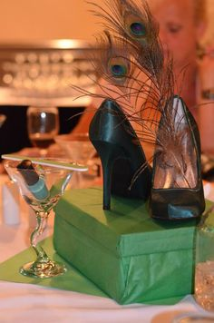 Stiletto shower-tini: centerpiece/gift for the bride. Shoes, jewelry and nail polish in matching colors. Doubles as great decor and great gift! Unique bridal shower theme :) #peacock