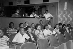 Children in unidentified theater.   Baltimore, Maryland,   ca. 1950-1960.   Paul Henderson (1899-1988).   4 x 5 inch acetate negative.   Baltimore City Life Museum Collection.   Maryland Historical Society,  HEN.00.B1-024.
