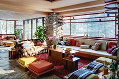 Frank Lloyd Wright - Fallingwater.  Banquette seating with storage for upstairs landing area.