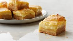 Butter Cake. Could there be more perfect words in a single recipe? Yep: Ooey Gooey Butter Cake Bars. You're welcome.