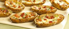 These bacon-filled potato skins make for a savory and fun appetizer or side dish. Top with cheese and sour cream for even more intense flavor.