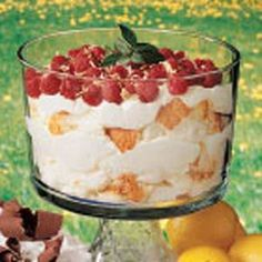 Lemon+Trifle----  Prep/Total Time: 15 min. Yield: 14 Servings  15  15  Ingredients  1 can (14 ounces) sweetened condensed milk  1 cup (8 ounces) lemon yogurt  1/3 cup lemon juice  2 teaspoons grated lemon peel  2 cups whipped topping  1 prepared angel food cake (8 to 10 ounces), cut into 1-inch cubes  2 cups fresh raspberries  1/2 cup flaked coconut, toasted  Fresh mint, optional