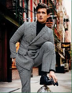 Garrett Neff wearing a Oversized Glen Plaid/Houndstooth Suit, and Black Turtleneck. Men's Fall Winter Fashion.