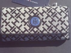Tommy Hilfiger Continental Women's Wallet [Clutch Purse Checkbook] by Tommy Hilfiger. $38.88. This Tommy Hilfiger clutch wallet offers stylish storage for all of your cards, cash, coins, and checks. The Ladies 3 Part Clutch features TH monogram on fabric like finish and a three fold design that secures with an adjustable snap closure. This wallet includes thirteen card slots for your credit cards, bank cards, membership cards, and medical cards, an ID window slot for your dr...