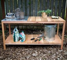 Looking at pictures of potting benches is discouraging, since they appear to be showpieces rather than working benches that need to store potting soil, fertilizer, etc.  This small garbage pail concept (for potting soil etc.) is the best idea I have seen for actual practical use.