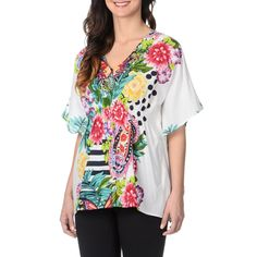 A refreshing floral print styles the bodice of this bohemian blouse by La Cera. This kimono top features a relaxed fit with airy elbow-length sleeves.