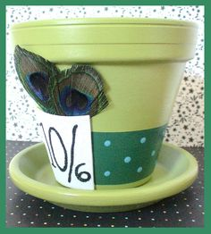 "Alice in Wonderland's Mad Hatter Inspired Flower Pot and Saucer - ""Tea Party Top Hat"" on Etsy, $23.00"