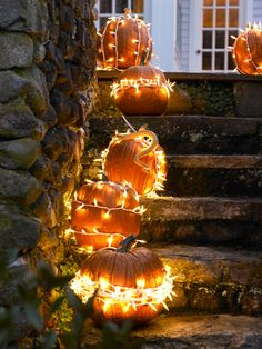 Set your stoop ablaze by stringing white outdoor holiday lights around regular pumpkins. It's a simple way to set a spooky mood—and illuminate your walkway!
