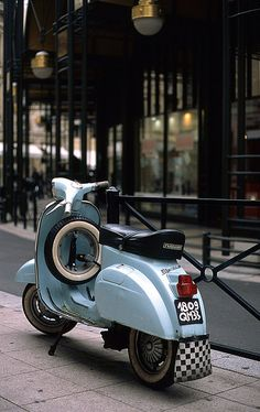 Vespa=now this would be fun!  love the checkered mud flap