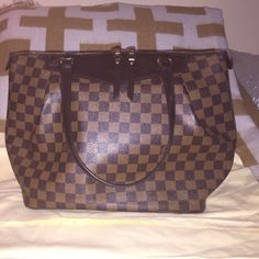 Louis Vuitton -Westminster GM Damier Handbag Louis Vuitton Westminster GM Demier handbag in EXCELLENT Condition. Comes with duster bag , original receipt of purchase & hang tags. Inside tag # SD2182. 100% authentic. Slight marks at front solid leather panel which are shown in the image.The top zipper opens to a red canvas interior including 2 patch pockets. This is an ideal tote for day with the luxury and style of Louis Vuitton! Louis Vuitton Bags Shoulder Bags