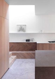 brushed concrete and herringbone wood kitchen