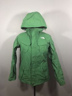Ladies small jacket in very very good used condition. It has a small mark on the back and some cracking on the zipper pull. North Face Ski Jacket, Green Jacket, Skiing, The North Face, Windbreaker, Raincoat, Clothes For Women, Lady, Jackets