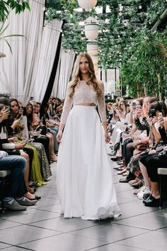 This crop top, two-piece wedding dress proves that long-sleeve wedding gowns can be totally sexy. Click for pictures of 30 other styles we love.