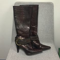 Leather Gianni Bini boots!!!!!! Beautiful leather. Brown with gold undertones, super cute boots from Gianni Bini. Alligator-type texture. Hardly worn at all, these have been sitting in my closet. There are no scuffs as you can see. Such an awesome pair of boots!!! Im looking for a good home for them. Strap with buckle can be removed. I'm open to reasonable offers! Gianni Bini Shoes Heeled Boots
