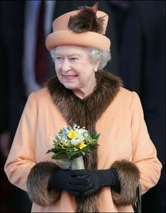 The queen pictured at an official opening of the Welsh Assembly Building in Cardiff, Wales. The monarch teamed her peach outfit lined with fur with a peach hat that has tufts of fur.