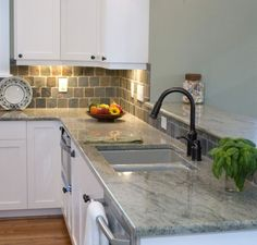 Great tile backsplash and marble counter top.  Love the look.