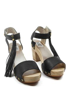 Throw it back to the 70's with these fab fringe clogs! www.mooreaseal.com
