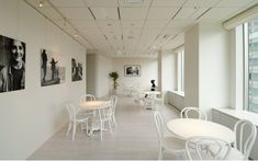 We are a global and creative design studio in Geneva, Tokyo and Beijing. White Tables, White Chairs, Showroom, Retail Experience, Retail Interior, Retail Space, Wood Floor, Retail Design, Stores