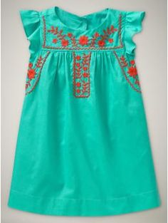 So cute! Way cuter than the mexican dresses my mom bought us as kids.