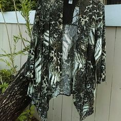 LUV ME MORE - ANIMALS & LACE - 3X Black and gray mixed animal print with lace shoulders and upper back - 3/4 sleeves - polyester/rayon/spandex  Size 3X Luv Me More Tops Tunics