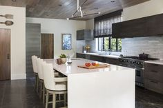 A rich assortment of materials and surfaces adds depth and texture without relying on bold color in this kitchen.