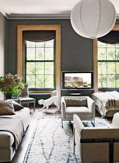 Dark neutrals in living room with paper lantern chandelier