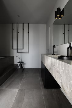 Masculine bathroom, Fior di Bosco marble, large Iris Ceramica tiles, roman tub and matt black Kholer taps. Designed by Sæja interior Designer