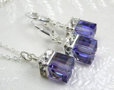 Gorgeous tanzanite hued Swarovski crystals mimic the real gemstones in color and sparkle. This purple crystal necklace and earrings jewelry set is