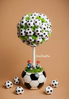 This is an excellent idea for a sports themed boy's room. A soccer inspired topiary would perfectly tie the room together addin… Soccer Birthday Parties, Football Birthday, Sports Birthday, Soccer Party, Sports Party, Birthday Party Themes, Boy Birthday, Soccer Centerpieces, Party Centerpieces