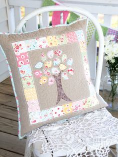 Stitch up a simply charming pillow by raiding your stash of colorful fabric scraps.