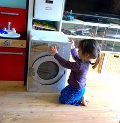 kid plays washing machine