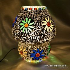 Mosaic Table Lamp  DL10609 Height-23cm Dia-19cm Elegant and Nobel Glass Handicraft Item Meticulous workmanship by expert hands of Professional workers , No child labour More than 20 years experience since 1994 Well and High Quality control Very competitive and unbeatable price Well packed with safety and gift packaging  Fast & prompt delivery  (15- 30 days)	 Reputed Brand name – Decent Lites Decorate your life with romantic atmosphere with family.