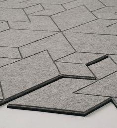 "studio Slovak Allt designed ""Cityscapes"", a carpet consists of modules concrete gray felt hard rubber (http://www.pinterest.com/AnkAdesign/design-materials)"
