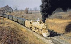 Chicago, Burlington & Quincy 4-8-4 #5632 (O-5b) is seen here with a fan trip near Bucklin, Missouri on November 1, 1964. It wears a special gold livery to celebrate the 50th anniversary of Kansas City Union Station's opening. Earlier that year the Northern was also dressed in gold to mark the centennial of Burlington's Chicago - Aurora main line. Walter Evans photo.