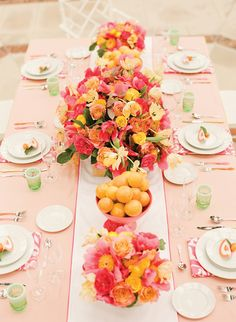 pink + orange centerpieces | Would love to do this with the pink satin sashes as table runner and white milkglass pedestal for bowl of clementines! Easter?