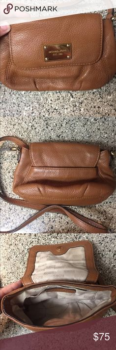 Michael Kors Jet Set Crossbody This is a Michael Kors jet set crossbody. It is brown leather and in excellent condition. Michael Kors Bags Crossbody Bags
