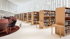 FRAME | How this old-school library in Finland was reframed as a 'public living room' Banks Office, Cozy Office, Office Inspo, School Library Design, Dubai, Timber Walls, Wood Cladding, Modern Library, Community Space