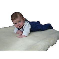 """Perfect for your Baby and Nursery Holy Lamb Organics Cozy Buns Organic """"On the Go"""" Happy Lamb Fleece Pad,Holy Lamb Organics Cozy Buns Organic """"On the Go"""" Happy Lamb Fleece Pad, This topper is approximately 18"""" x 26"""", 1.5"""" thick and is Unmatched in its Softness. Lush and cloud-soft, the Happy Lamb Fleece Topper is a Natural Alternative to Sheepskin and is Always Ready to Receive and Support..."""