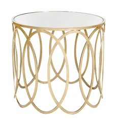"With an iron base of overlapping ovals, the circular Olivia side table stands with elevated style in living rooms. Topped with an elegant mirrored surface, Worlds Away's metallic furnishing makes a glamorous yet refined statement. Striking when paired with transitional sofas, this accent complements a myriad of glamorous designs. 20"" Diameter x 18""H. Available in Gold Leaf and Silver Leaf."