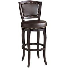This is the chair that inspired my bed design. Dark wood, brown leather, and nailheads! I, of coarse, would do nickel nailheads instead of brass, but it'll happen!