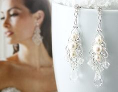"Bridal Earrings Wedding Earrings Wedding by goddessdesignsgems, $46.00 ""Exquisite"" these chandelier earrings are vintage inspired, the scrolling design is simply beautiful. Earrings are made with silver plated filigree and embellished with 3 beautiful genuine ""Freshwater Pearls"" in the center and finished with sparkling crystal clear Swarovski crystals drop crystals. Earrings are silver crystal enhanced post style and measure approx 2 3/4"" in length."