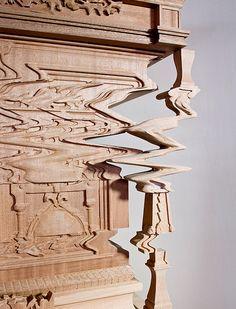 Distorted cabinet carved to resemble a digital glitch | Ferruccio Laviani