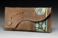 lucid cartera de mano en cuero cuero  metal  pintura marroquineria
