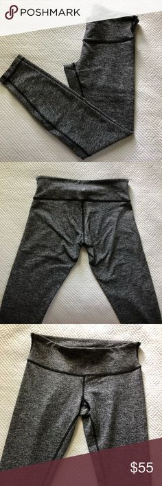 Lululemon Wunder Under Leggings In excellent condition, only worn a couple times. No visible marks of wear. Tag is cut out from inside.   They are high waisted and full length. They are the Luon fabric, so they are a very soft cottony fabric. The color is a heathered dark gray. lululemon athletica Pants Leggings