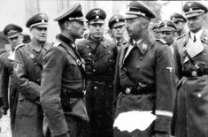 Himmler on one of his many visits to military installations. Right behind him is his adjutant, SS-Obergruppenführer and General of the Waffen-SS Karl Wolff. Behind Wolff, on the left, Martin Bormann, head of the Party Chancellery and private secretary to Hitler, 1943.
